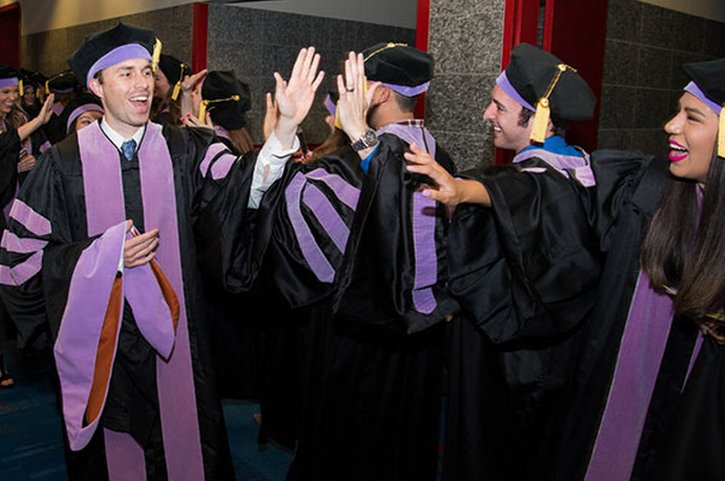 Photo of UTHealth School of Dentistry graduates celebrating. UTHealth commencement ceremonies begin May 15. (Photo credit: UTHealth)