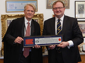 Ishee holding his Freedom of City of London award