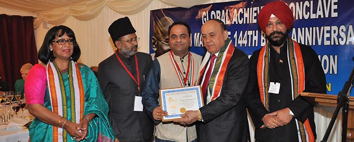 Ashish Joshi accepting an award given by Indian government officials